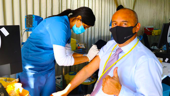 James Lynch, Principal of of Ambassador International Academy in Dubai received the vaccination against Covid 19 in 2021