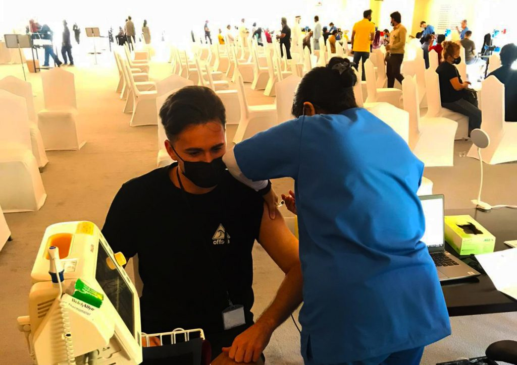 Sam Buse, Teacher and Head of House, Hartland International School in Dubai shown being vaccinated against Covid 19 as part of the largest free vaccination programme in UAE history.