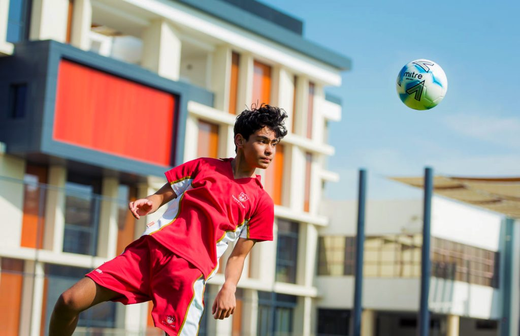 Top tier league competition is a key feature of sporting life at the English College Dubai. Here a young man trains for the First Football Team.