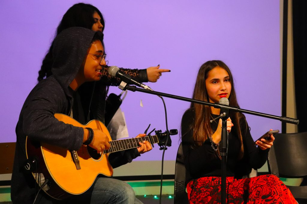 The music curriculum is a strength at North American International School in Dubai. Here we see a young guitar player and vocalist performing for parents and the school.