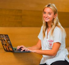 Review of the English College Dubai with a photograph highlighting the happy school dynamics and a Sixth Form student engaged in study for A' Levels