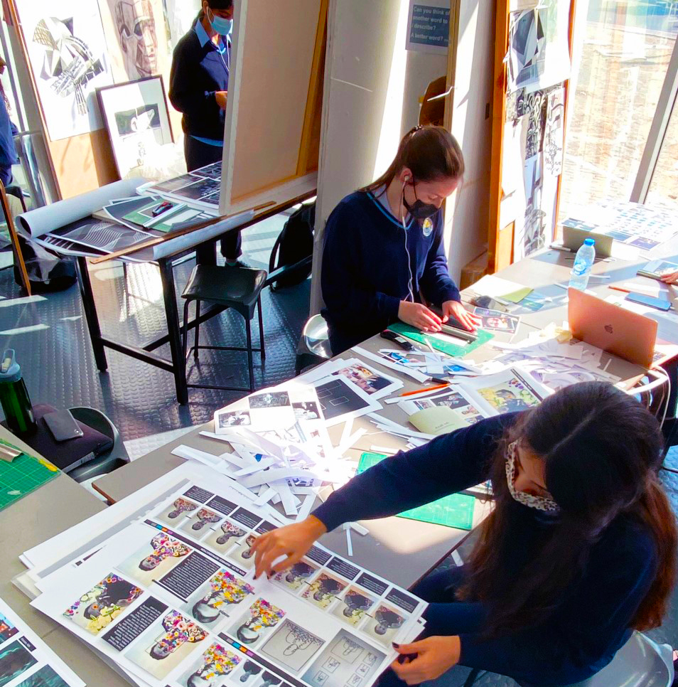 Photograph of students working collectively on their entry to Junk Kouture in the UAE 2021. Here students at the British School Al Khubairat are designing in the Art Labs.
